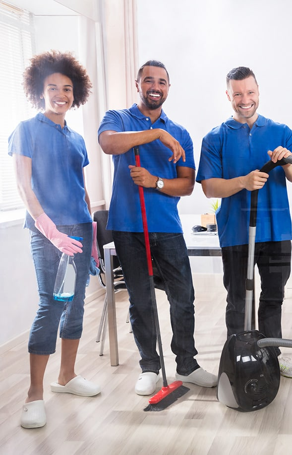 Male And Female Janitors With Cleaning Equipment