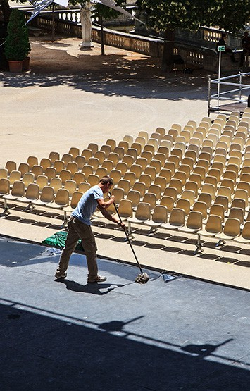 man cleaning a stage