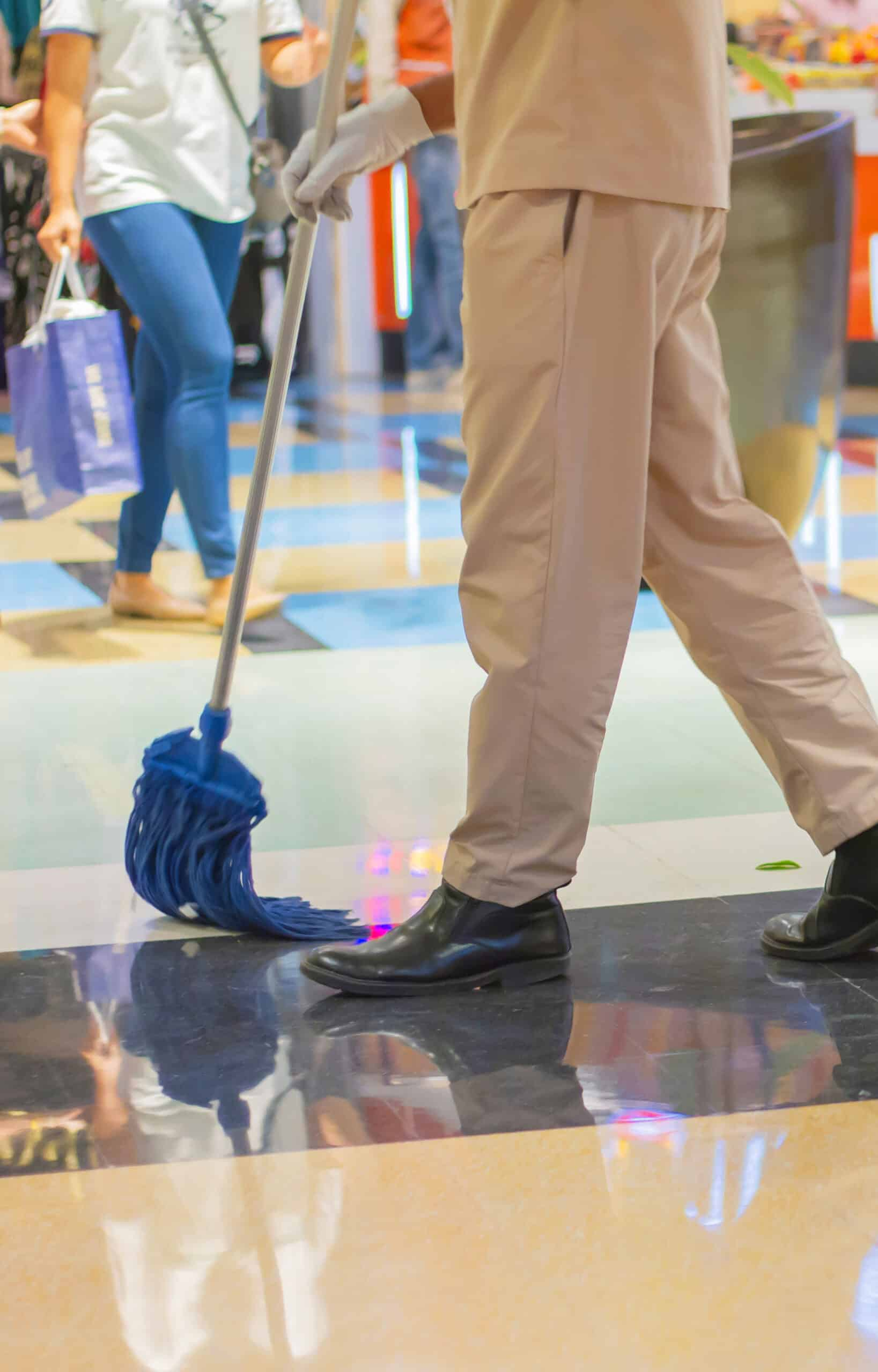 janitor people cleaning floor in the mall