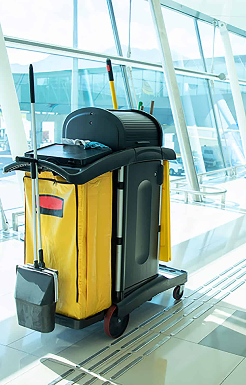 yellow cleaning cart by window